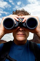 Close_up of man with binoculars