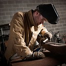 USA, Utah, Orem, welder working in workshop