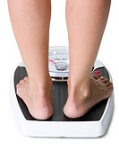 Bare feet on a weight scale