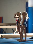 USA, Utah, Orem, girls 10_11 standing on mat in gym
