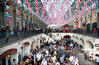 England. London. Union jack flag buntings decorate Covent Garden market interior.