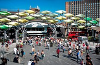England. London. Crowds of people outside Stratford Shopping Centre showing the ´Stratford Shoal´ sculpture.