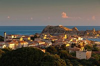 France, Corsica, Haute-Corse Department, La Balagne Region, Ile Rousse, elevated city view with Ile de la Pietra, dawn