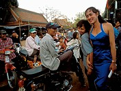 Cambodian Transvestite and Scooter Riders