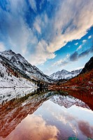 Maroon Peak, left, and North Maroon Peak, right, also known as The Maroon Bells, reflected in Maroon Lake. Maroon Peak is 14,163 feet, or 4,318 meters...
