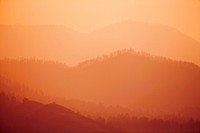 Ridges and mountains obscured by smoke from raging wildfire, northern Colorado, USA