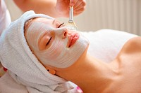 An attractive young woman having a facial treatment