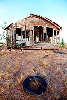 Old tire and abandoned ranch house, eastern plains of Colorado, USA