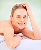 Smiling young woman feeling relaxed at a day spa
