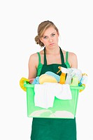 Portrait of tied maid carrying cleaning supplies