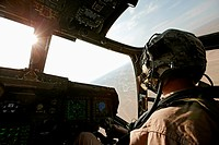 A U.S. Marine Corps aviator in the cockpit of an MV_22 Osprey during a combat operation in southern Afghanistan´s Helmand Province.