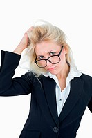 Portrait of frustrated business woman scratching head
