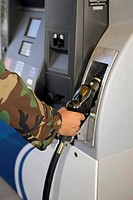 Airman at Gas Pump