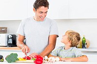 Father preparing vegetables with son