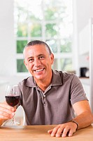 Man holding glass of red wine