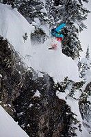 A young male snowboarder freeriding in the Revelstoke Mountain Resort Backcountry, BC