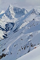 A male backcountry skier enjoying fast, deep turns in the alpine, Icefall Lodge, Golden, BC