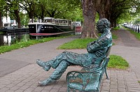 Sculpture of Irish poet Patrick Kavanagh 1904_1967, located on the bank of the Grand Canal Dublin near Baggot Street bridge, Dublin, Ireland