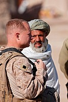 A U.S. Marine speaks with a Pashtun man, southern Helmand Province, Afghanistan.