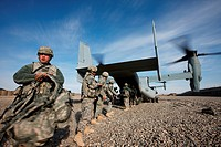 U.S. soldiers unload gear from a U.S. Marine Corps MV_22 Osprey at a combat outpost in Helmand Province, Afghanistan.