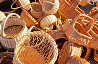 Handmade basket bags stacked pile sell fair market