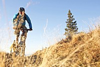 Two mountainbikers riding on a trail in the Alps, Alpspitz, Bavaria, Germany, Europe