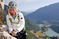 Young woman climbing fixed rope route Rino Pisetta, Lago die Toblino, Sarche, Calavino, Trentino, Trentino_Alto Adige, Suedtirol, Italy