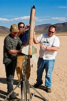 A group of men sets up a rocket for launching at Springfest ´06 on Jean Dry Lake in Nevada.