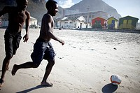 Boys playing football on the beach, Muizenberg, Peninsula, Cape Town, South Africa, Africa
