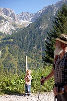 Child and mountain guide on a hiking path in the mountains, Gossensass, Brenner, South Tyrol, Trentino_Alto Adige/Suedtirol, Italy