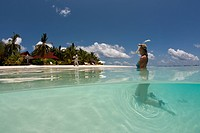 Woman with snorkel in the shallow water, North Male Atoll, Indian Ocean, Maldives