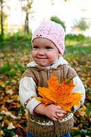 Nice baby with leaves