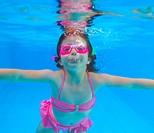 underwater little girl pink bikini blue swimming pool