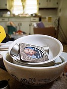 A kid's school picture in dishes inside a foreclosed home in Haw River, North Carolina, United States