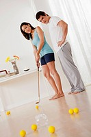 Couple playing mini golf at home