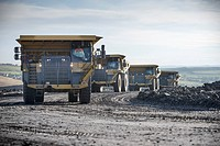 Trucks with coal rocks at surface mine