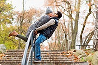 Couple kissing over park railing