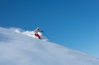 Skier on snowy slope