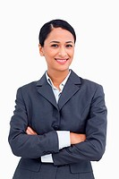 Close up of smiling saleswoman with arms folded