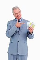 Mature tradesman pointing at his money