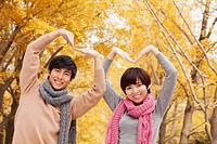 Chinese couple making heart shape
