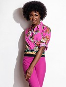 Beautiful smiling young african american woman wearing pink floral top and pants  Fashion photo isolated on white background