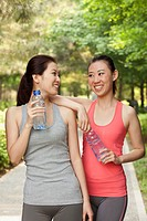 Chinese women drinking water after exercise