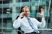 Caucasian businessman talking on cell phone