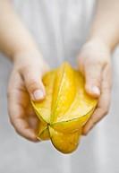 Caucasian child holding fruit