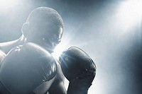 African American boxer with gloves raised