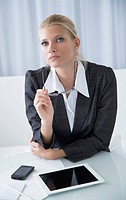 Business woman with cell phone and tablet