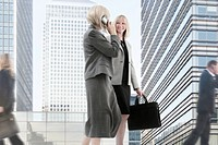 Businesswomen travel to a city meeting together