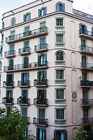 Facade of building in the Eixample of Barcelona, Avda Diagonal, 366, constructed in 1936 It has the 5th floor with arched windows, unlike the others f...