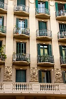 Façade decorated with borders overloaded with 3 faces of men that looking at street Constructed in 1935 Mallorca street nº 352, Barcelona The rest of ...